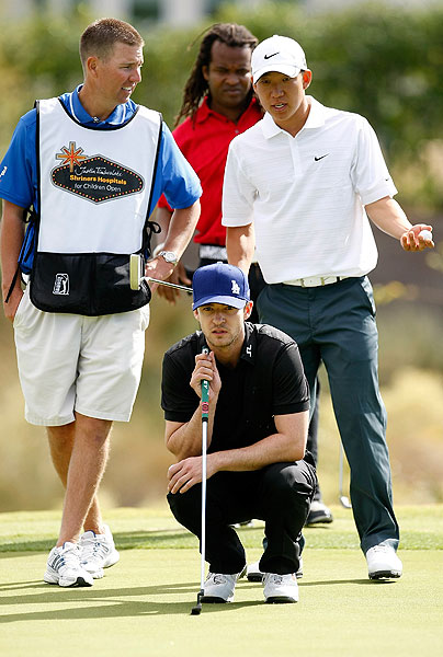 got help reading his putt from Anthony Kim during the Justin Timberlake Shriners Hospital Pro-Am on Wednesday.