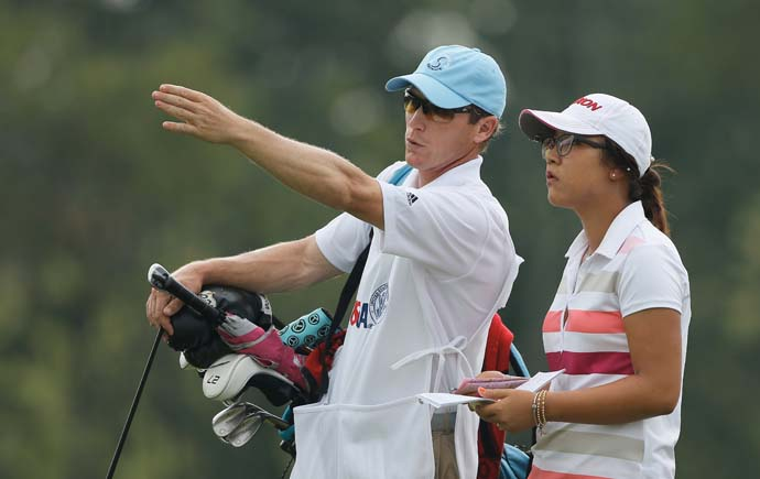 """Half of my actual shots are pretty much know my caddie Louis's thoughts.  He's like, Okay, hit it over there,"" and I hit it there.  And that's been working so far.  He's the more creative one at the moment.""                       --Lydia Ko, with caddie Louis De Kerillis in photo, on her creativity as a golfer."