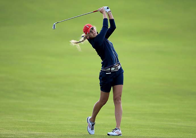 "Jessica Korda plays her third shot on the first hole Saturday morning. After Korda threw up during her opening match on Friday, U.S. captain Meg Mallon remarked, ""Bill Russell used to throw up before every game."""