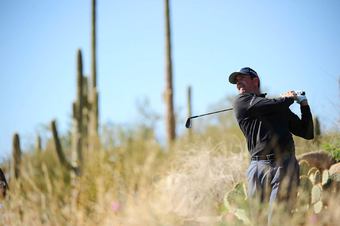 Matt Kuchar defeated Robert Garrigus, 3 and 2, to reach the semifinals.