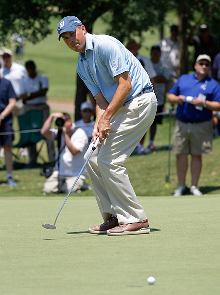 Matt Kuchar fired a four-under 66 to get within two shots of leader Ryan Palmer.