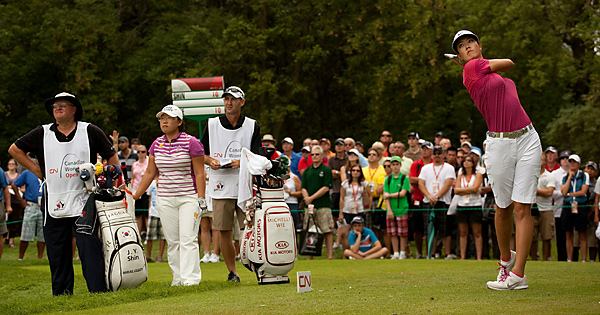 Wie was tied with Jiyai Shin (in striped shirt) entering the final round, but Wie shot a 70 as Shin fired a 73.