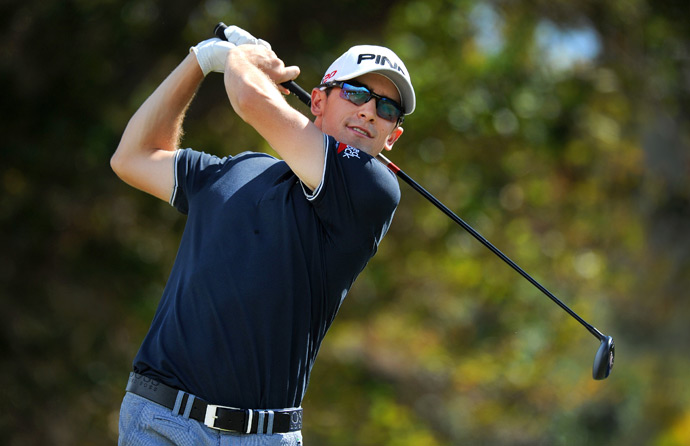 Scott Langley made seven birdies and two bogeys to finish with a share of the lead heading into Sunday.