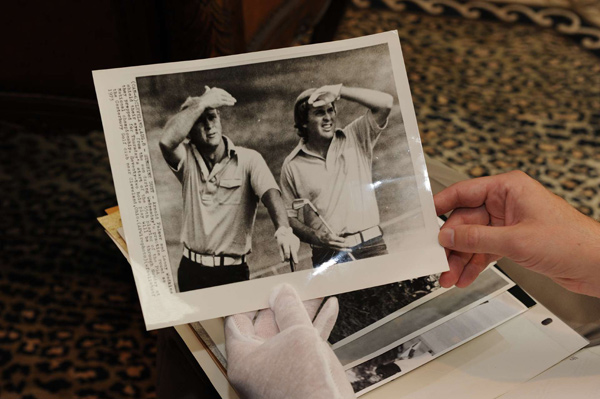 "A photo of a young Wadkins with Arnold Palmer. Wadkins said of the photo, ""We had our matching Seventies belts."""