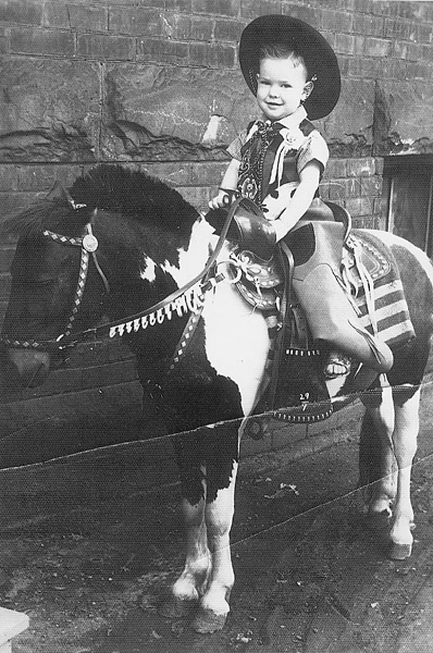 I lived in Detroit for about six months. This pony and these cowboy outfits were brought around to various housing projects, where parents would pay to have their child's picture taken. We moved to Detroit because my father was a car-body repairman in Alabama and got a job working for an automotive manufacturer.