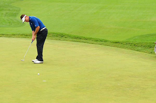 "Lee Westwood opened with three-straight birdies on the back nine.                                           function fbs_click() {u=""http://www.golf.com/golf/gallery/article/0,28242,1905392,00.html"";t=document.title;window.open('http://www.facebook.com/sharer.php?u='+encodeURIComponent(u)+'&t='+encodeURIComponent(t),'sharer','toolbar=0,status=0,width=626,height=436');return false;} html .fb_share_link { padding:2px 0 0 20px; height:16px; background:url(http://b.static.ak.fbcdn.net/images/share/facebook_share_icon.gif?8:26981) no-repeat top left; }Share on Facebook                                                                                                                                                                        addthis_pub             = 'golf';                                           addthis_logo            = 'http://s9.addthis.com/custom/golf/golf_logo.jpg';                                          var addthis_offset_top = -155;                                          addthis_logo_color      = '555555';                                          addthis_brand           = 'Golf.com';                                          addthis_options         = 'email, facebook, twitter, digg, delicious, myspace, google, reddit, live, more'                                                                                                                                Share"