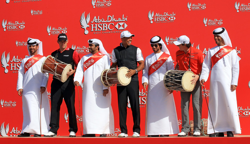 From left to right:  Lee Westwood, Tiger Woods and Rory McIlroy participated in a traditional Emirati Ayala dance before the Abu Dhabi HSBC Golf Championship.