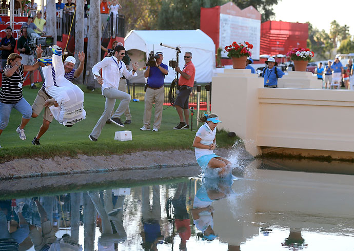 Lexi Thompson, her caddie and family jump into Poppie's Pond after her three shot win during the final round of the 2014 Kraft Nabi