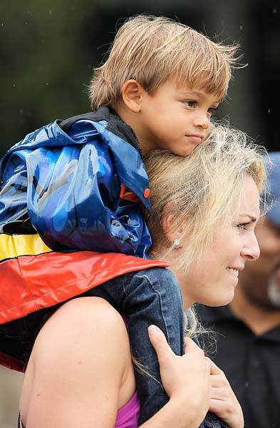 Lindsey Vonn and Charlie Woods watch Tiger at the Tour Championship on Saturday.