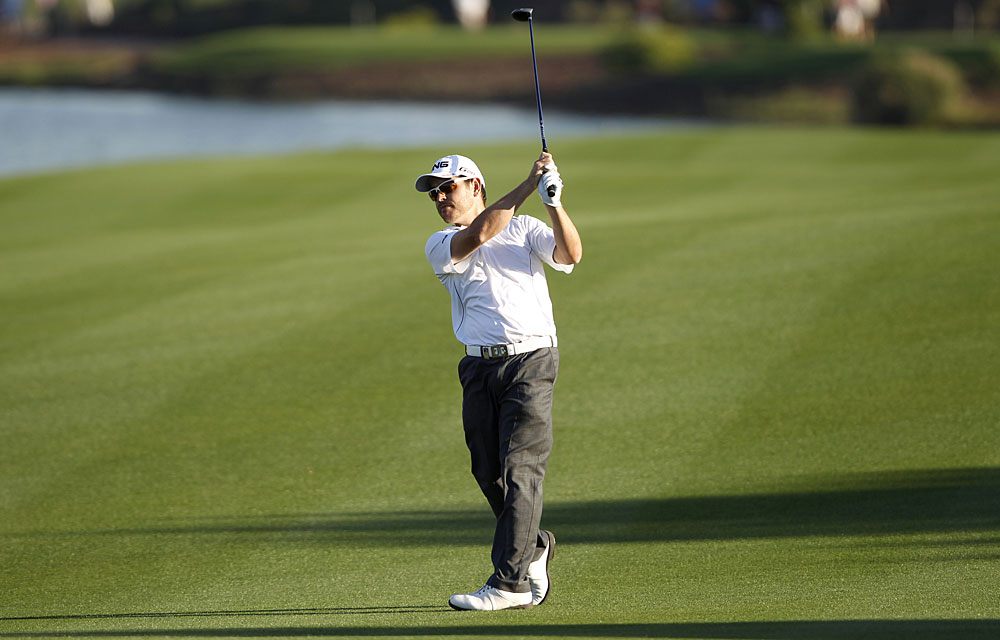 Louis Oosthuizen shot a six-under 66 to move into third place.