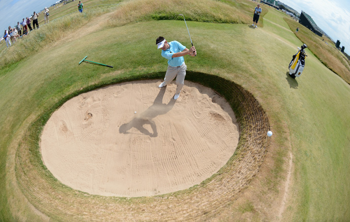 Louis Oosthuizen blasted out of a bunker on the 13th hole Tuesday. Oosthuizen will play with Tiger Woods and Graeme McDowell on Thursday and Friday.