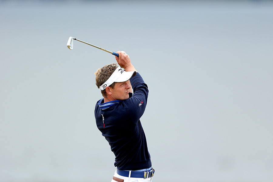 Defending champion Luke Donald birdied the last two holes for a four-under 68.