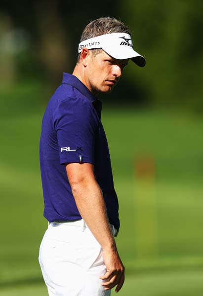 Luke Donald was in the running for second place at the Bridgestone, but made three bogeys on the back nine to finish T9. Maybe that's why he looked so glum at Oak Hill on Monday.