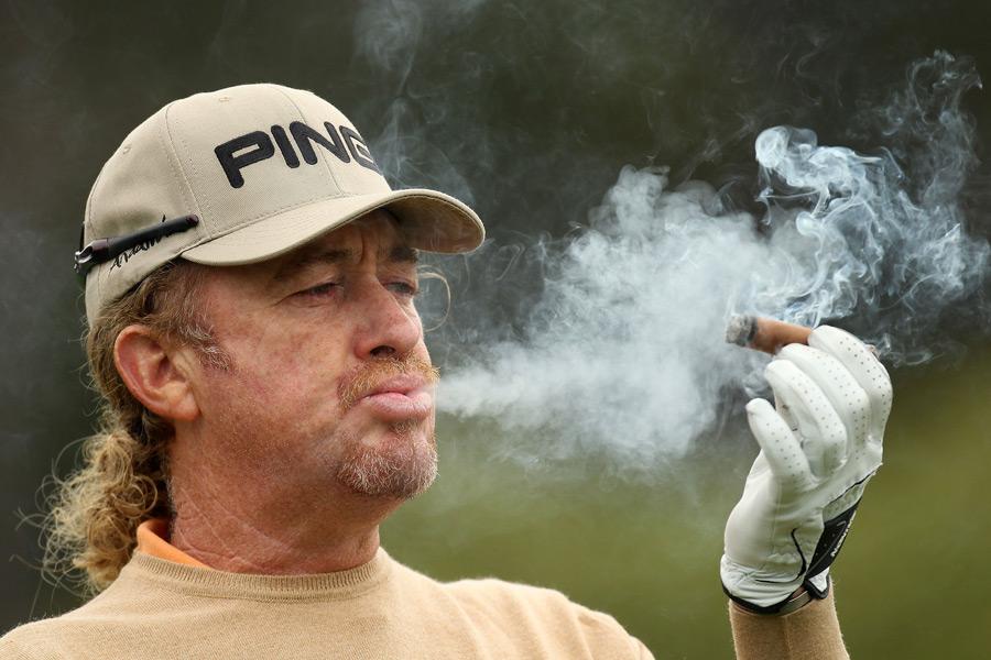 Jimenez enjoys a fine cigar on the course ...