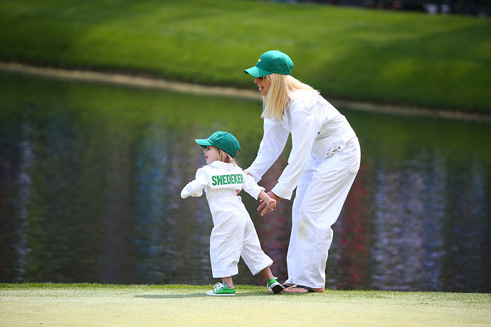 Mandy Snedeker caddied for her husband on Wednesday.