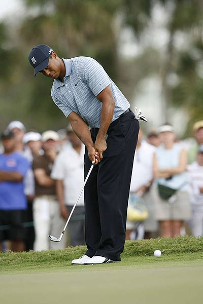 Tiger Woods bogeyed his final hole, but is only two strokes off the lead.