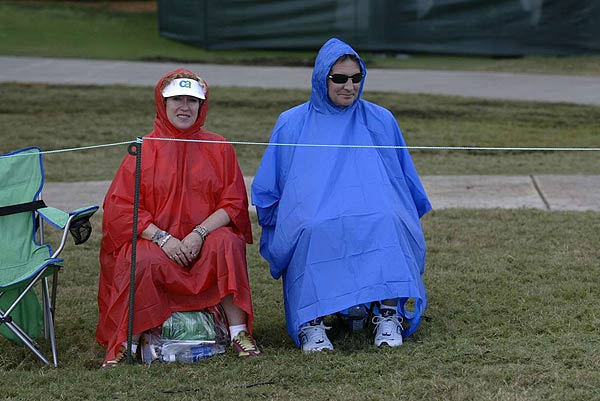 Dedicated fans waited for play to resume for hours in the rain.