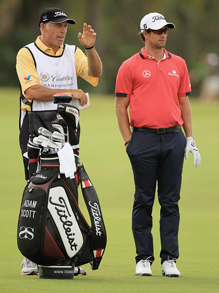 Adam Scott shot a six-under 66 to tie for the lead with Jason Dufner.