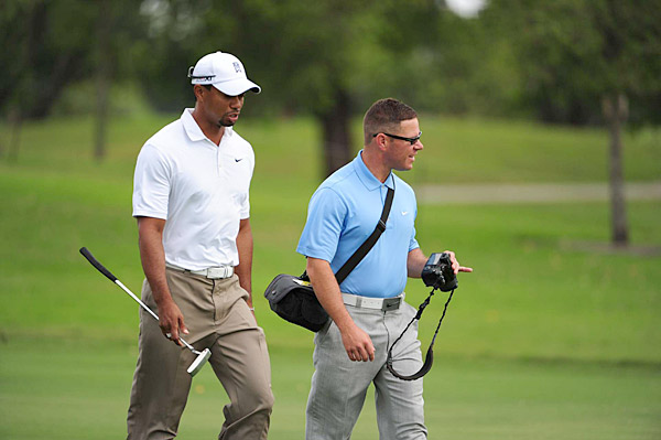 Tiger Woods was hard at work with swing coach Sean Foley Wednesday morning.