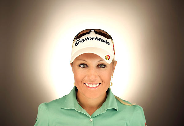 Natalie Gulbis earned her first victory last year at the Evian Masters.Read GOLF.com's interview with Gulbis, watch the video, and see her calendar shots and a swing sequence.