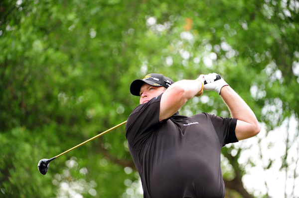 Jason Gore dropped out of second place with a double bogey on 18.