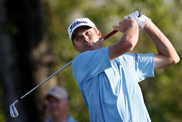 Defending champion Nick Watney made an eagle, four birdies, and a bogey to move into contention.