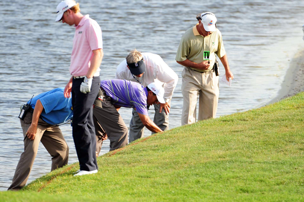 On 18, Woods again found the rough on his drive. His second shot failed to clear the hazard, and Woods lost his ball.