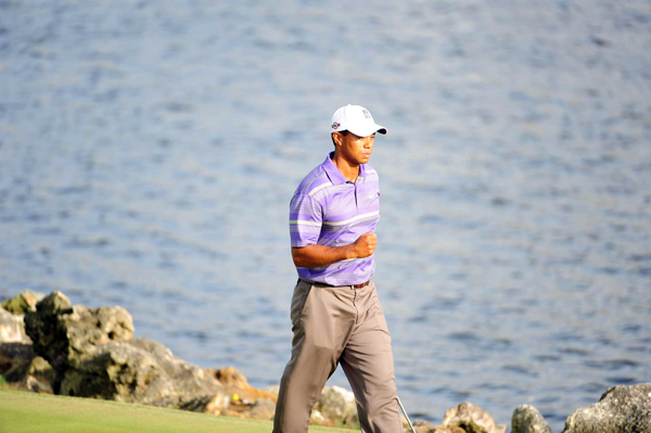 After he hit his fourth shot on the green, Woods drained the putt to save a bogey.
