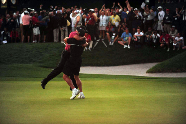 After a couple of fist pumps, Woods jumped into the arms of his caddie, Steve Williams.