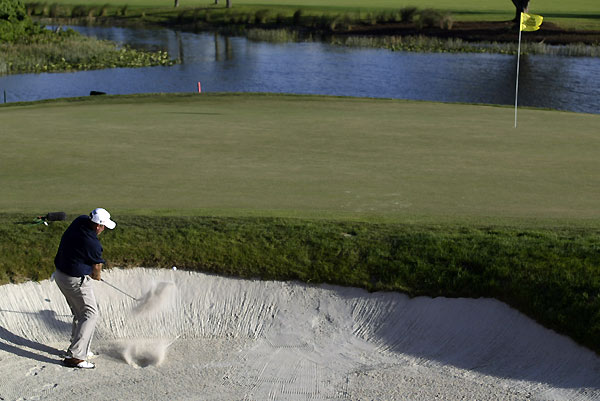 Mark Calcavecchia was tied for the lead until he hit into a greenside bunker at the par-3 15th. His shot from the sand looked fine at first, but it never stopped rolling and came to rest in the hazard, on a rock ledge above the water. He tossed the ball in, made double bogey and finished tied for fourth.