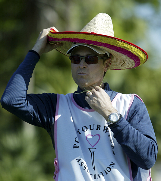 Estes adjusted his sombrero before he played a shot for his wife.
