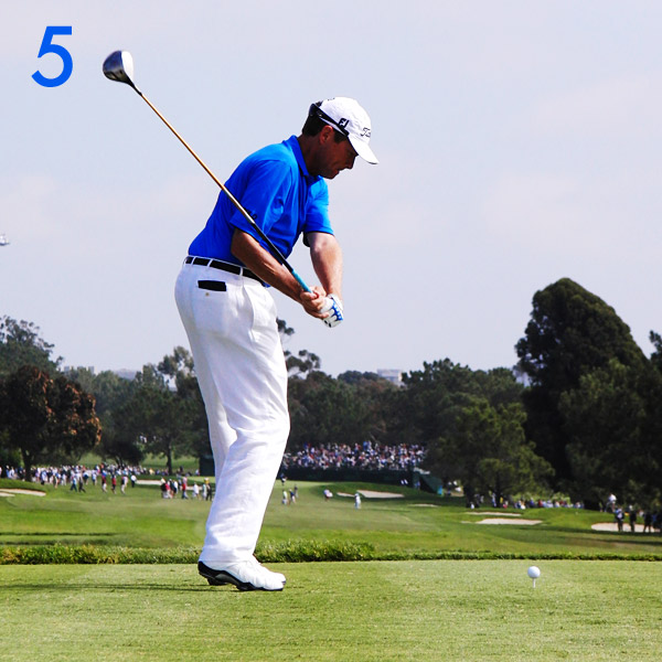 5. Davis starts his downswing from the ground up. His lower body initiates his forward move as his arms drop to flatten his swing. This move increases his lag and gives the clubhead a direct path to the inside-back quadrant of the ball.                       Lower-body action at the start of his downswing flattens the shaft.