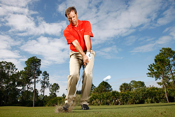 How to Play It                                          When you find yourself well off the green with fairway or any mown area between you and the hole, the safest shot is a bump and run. Play the ball back in your stance and place most of your weight on your left side. This setup will help you hit the ball crisply on the way down and decrease the chance of blading or chunking the shot. Once you're set up correctly, pick your landing spot while visualizing the run of the ball all the way up to the hole. Hit the shot like you would a lag putt, simply trying to get it close.