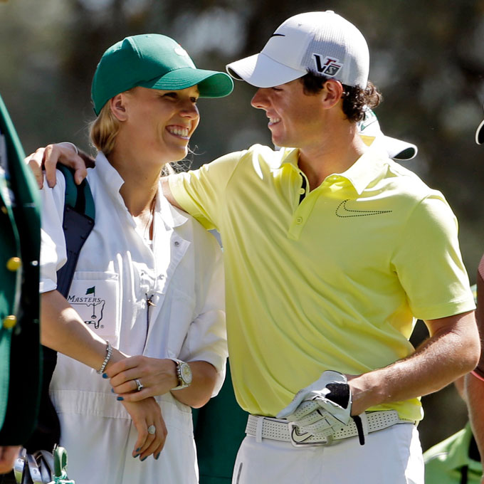 Caroline Wozniacki caddies for Rory McIlroy during the 2013 Par-3 Contest before the Masters. During their relationship, Caroline often attended Rory's tournaments and enjoyed caddying in the Par-3 Contest at Augusta National.