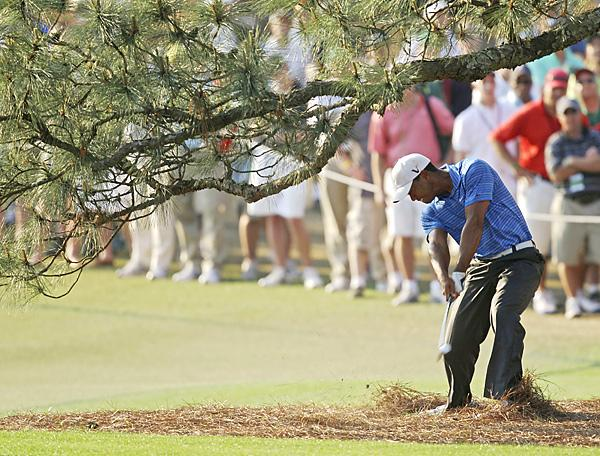 2011 Masters Championship: Woods suffered a minor MCL sprain in his left knee and minor strain of his left Achilles' tendon while executing this shot from underneath the Eisenhower tree on the 17th hole in the third round of the Masters.