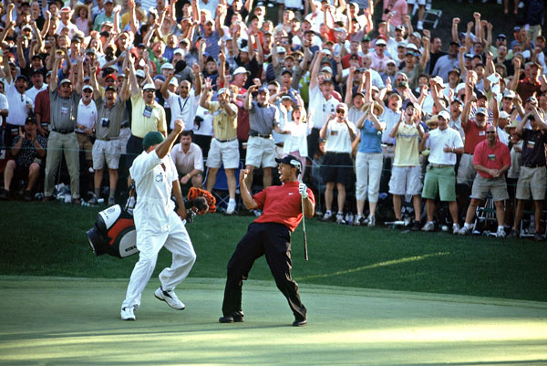 Greatest Masters Matches                                          2005                     Tiger Woods vs. Chris DiMarco                     276-276*                     (Won playoff at first hole)                                          Major-less since 2002, Woods strode to the 16th tee with a one-shot lead. He missed long, while DiMarco found the heart of the green. DiMarco then watched helplessly as Woods chipped from 25 feet, aiming well away from the hole, only to see Woods' ball slither down a slope, apparently stop on the edge of the cup, and then drop in for a stunning birdie. Woods bogeyed 17 and 18 and went into a playoff with DiMarco. But Tiger drained a 15-footer on the first playoff hole to claim his fourth green jacket.