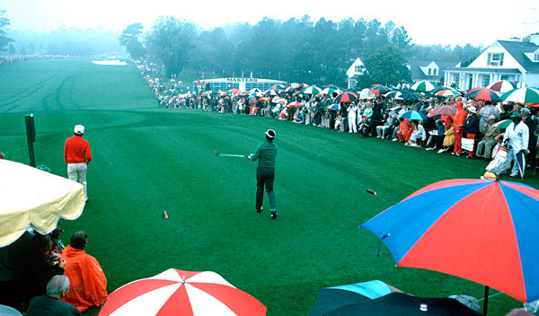 """This was taken early Thursday                       morning. Lee Elder was the first                       African-American to play the Masters.                       The club photographer had used a                       ladder for a group members shot and                       left it behind the first tee. I climbed up                       and captured this historic tee off!""                                              — Leonard Kamsler for Golf Magazine"