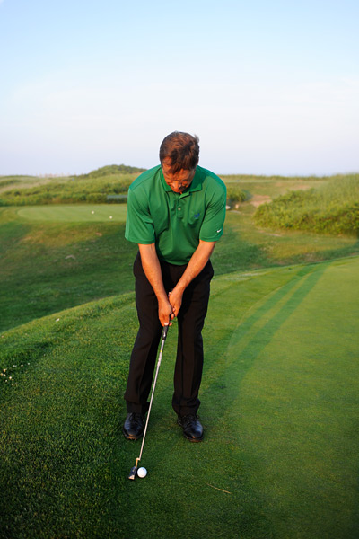 How to Putt From the Fringe                        Keep your back foot on the green to beat this tricky putt                       By Eden Foster                       Top 100 Teacher                                              This story is for you if...                                              • You don't know how to adjust your stroke from this lie...                                              • ..so your blade catches the grass behind the ball.                                              The Situation                       Your ball landed on the green, but the ball is so close to the fringe that your putter will catch the rough on your backstroke.                                              The Solution                       To make this putt you need to replace your normal level putting stroke with a more up-and-down motion. When you set up, make sure your back foot is on the green or the fringe so that your putter is opposite your right foot or even behind it. Then lean a little more weight onto your left leg and press the shaft forward. These setup adjustments automatically create a more vertical or up-and-down putting stroke.