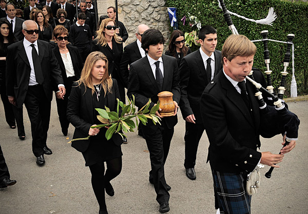 Seve's eldest son, Javier, carried his father's remains while leading the procession to the church. Javier was flanked by sister Carmen, left, and younger brother Miguel, right.
