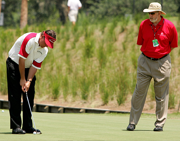 Phil Mickelson talks to his short-game coach, Dave Pelz, on the putting green before the second round of the Players Championship.                                              Tips and articles from Dave Pelz, Phil's short-game coach