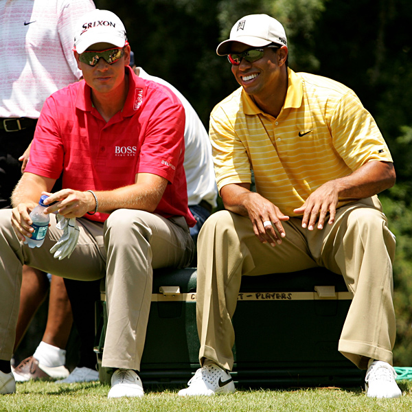 Tiger Woods chatted with Henrik Stenson before they teed off on the 2nd hole.