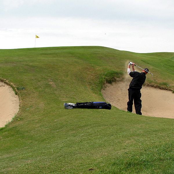 "Coyne blasts out to the first green at Lahinch. ""The course is a stunner all the way around, and though I'd been there before, it was a whole new place,"" he said.                                               Course Called Ireland: Committed in Connemara"