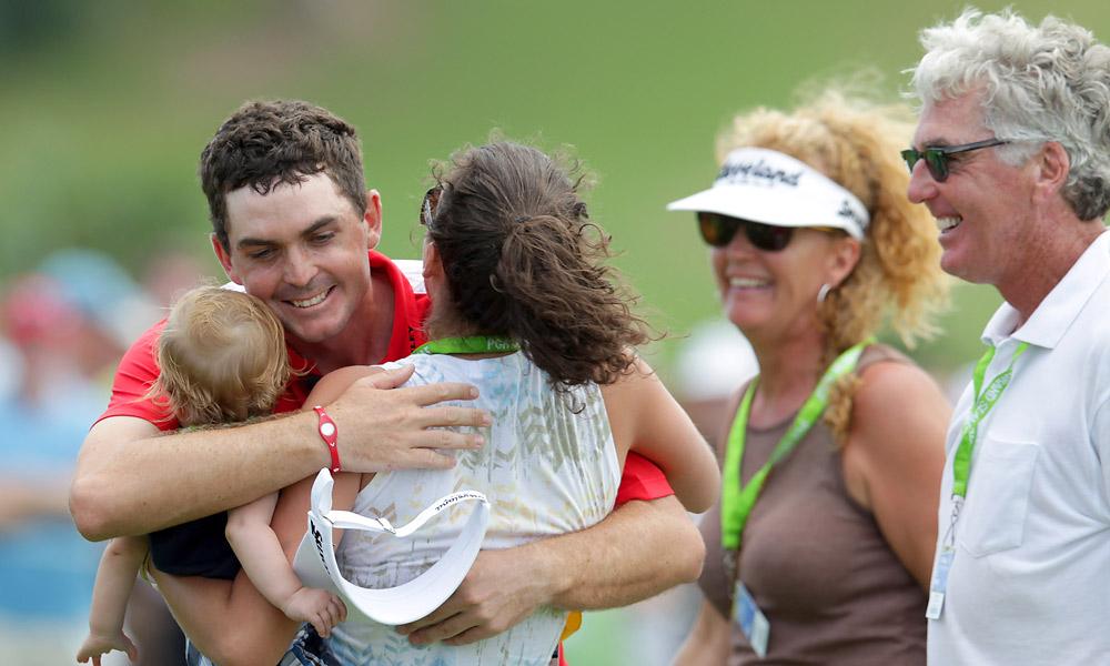 Keegan and Mark Bradley                     Mark Bradley, a PGA professional, joined his family in celebrating Keegan's victory at the 2011 PGA Grand Slam of Golf.