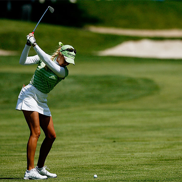 Natalie Gulbis, left, had four birdies and two bogeys in her first round at the Sybase Classic Thursday.                      Sarah Lee shot 66 to take a two-stroke lead over the defending champion, Lorena Ochoa.