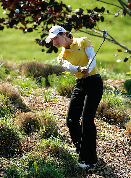 Lorena Ochoa found herself in the shrubbery on the 12th hole. She scored a double bogey.                      • Ochoa defending title at Sybase Classic