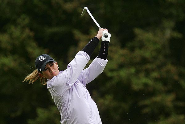 First Round of the Corning Classic                       Erica Blasberg shot a bogey-free 65 for the lead on a cold day in New York.