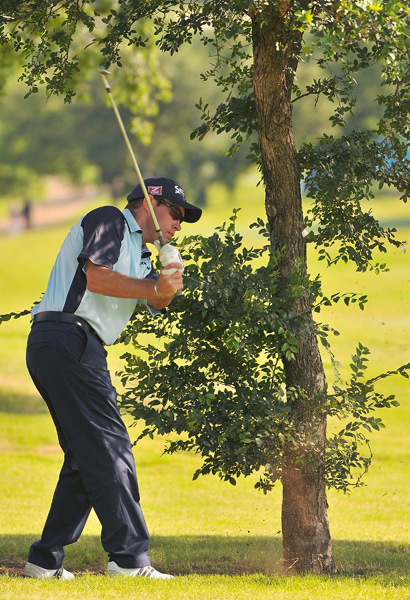 Brian Davis had to play a left-handed shot, but he still managed to shoot a 65.