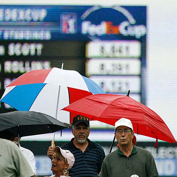 Friday at Colonial                       After a soggy Thursday, play resumed Friday at Colonial Country Club, site of the 2007 Crowne Plaza Invitational. Have a look at some of the day's best shots.                                              After huge thunderstorms halted play early on Thursday, fans were still dodging rain drops at Colonial Country Club Friday.