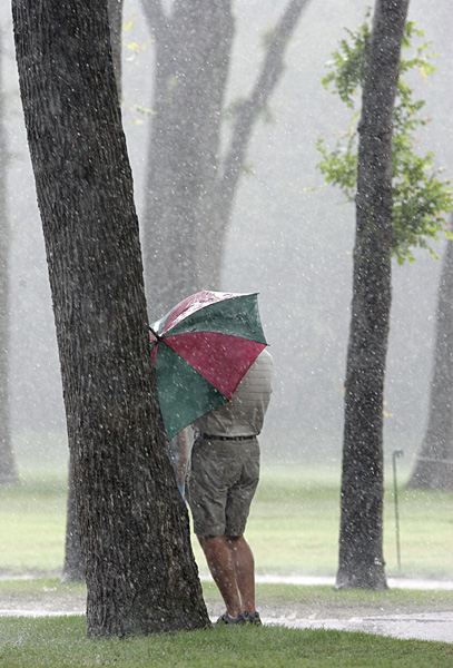 A Packed Saturday                       The weather was the story on Saturday at the PGA's Crowne Plaza Invitational, left, but things proceeded according to plan at the Senior PGA Championship, the LPGA's Corning Classic and the BMW PGA Championship in England.                                              A fan took shelter during one of Saturday's many downpours at Colonial Country Club in Fort Worth, Texas, site of the Crowne Plaza Invitational.