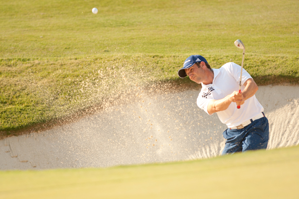 is battling an infected fingernail, but he is tied for the lead with Ryan Palmer heading into the weekend.
